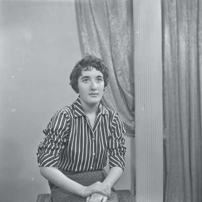Portrait of a young woman in striped shirt