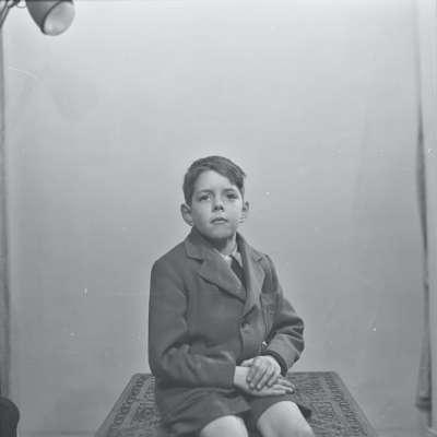 Portrait of a boy in a coat