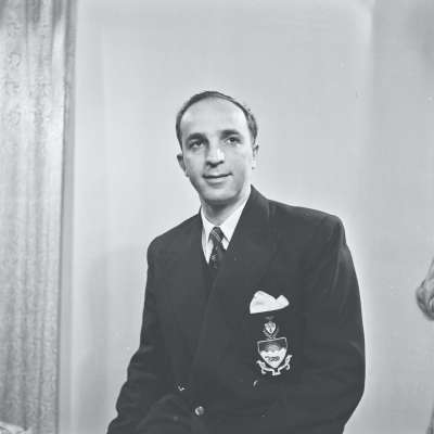 Portrait of a man wearing blazer with insignia