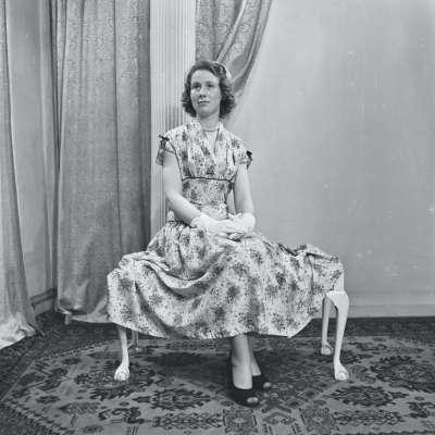 Portrait of a woman in a patterned dress