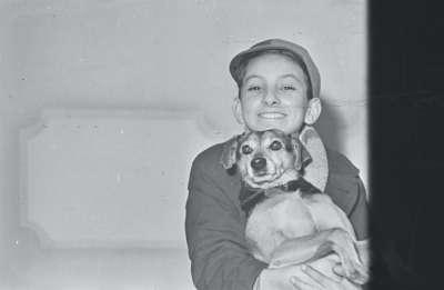Portrait of a boy with a dog