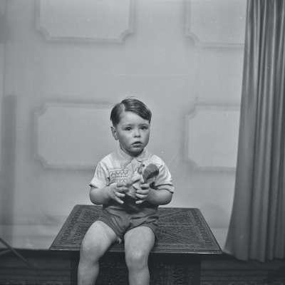 Portrait of a boy holding doll
