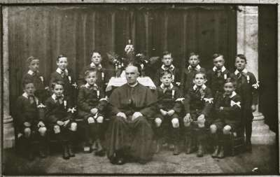 Group portrait with Priest