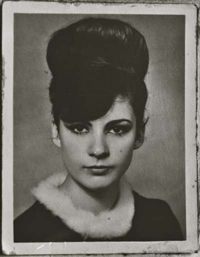 Portrait of a young woman wearing fur collar