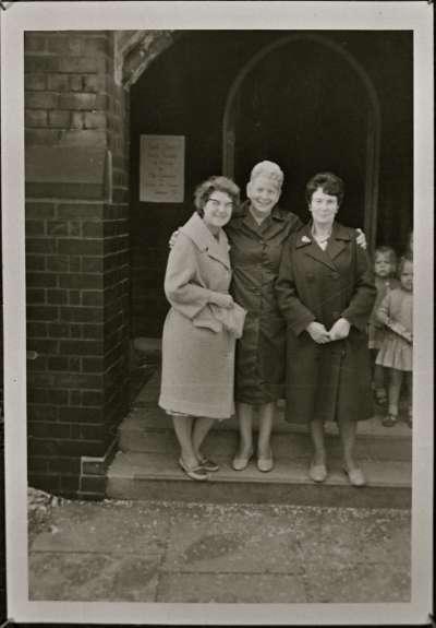 Portrait of three women outside Church