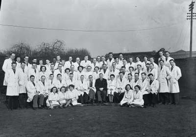 Outdoor portrait of Group in White Overalls