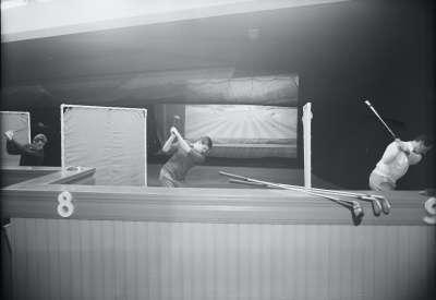 Trio Practicing Golf Swings