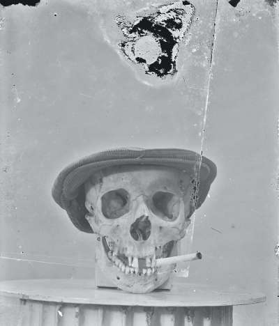 Advert of skull with hat and cigar