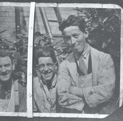 Copy photograph of two male workers