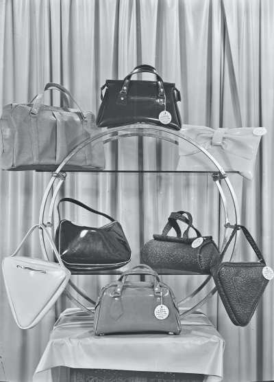 Series of handbags on  a display stand