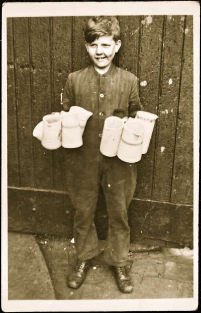 Boy carrying jugs