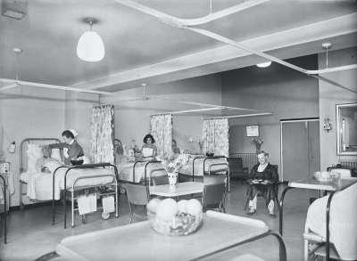Hospital ward interior with nurses