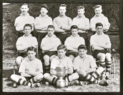 Group of boys holding cup