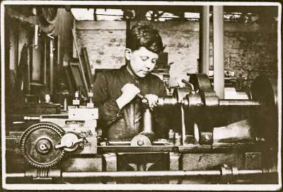Boy working lathe