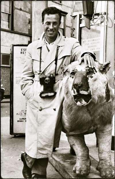 Man with camera and stuffed animal