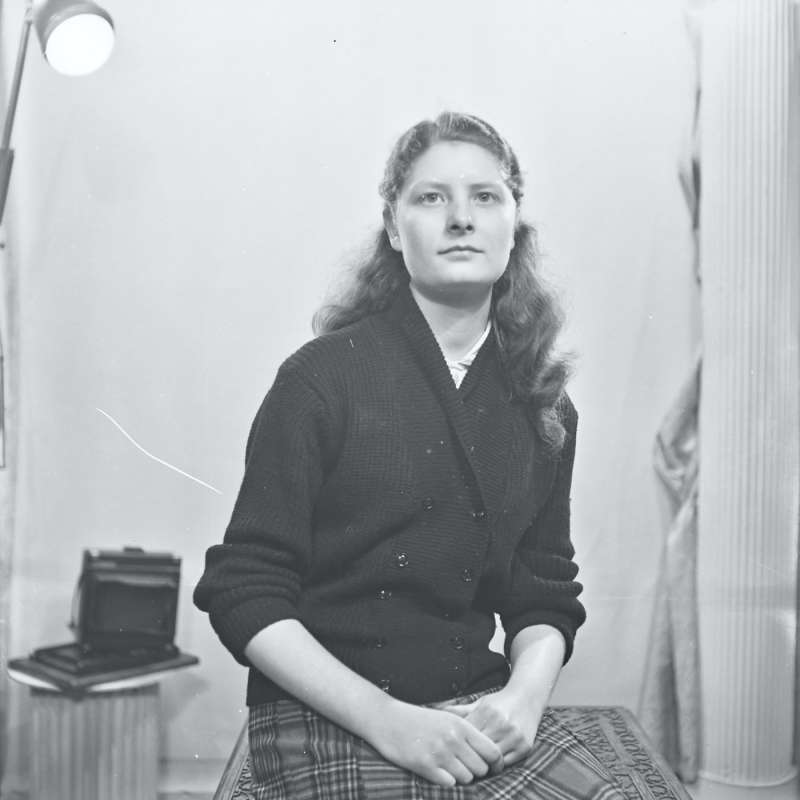 Portrait of woman with tartan skirt