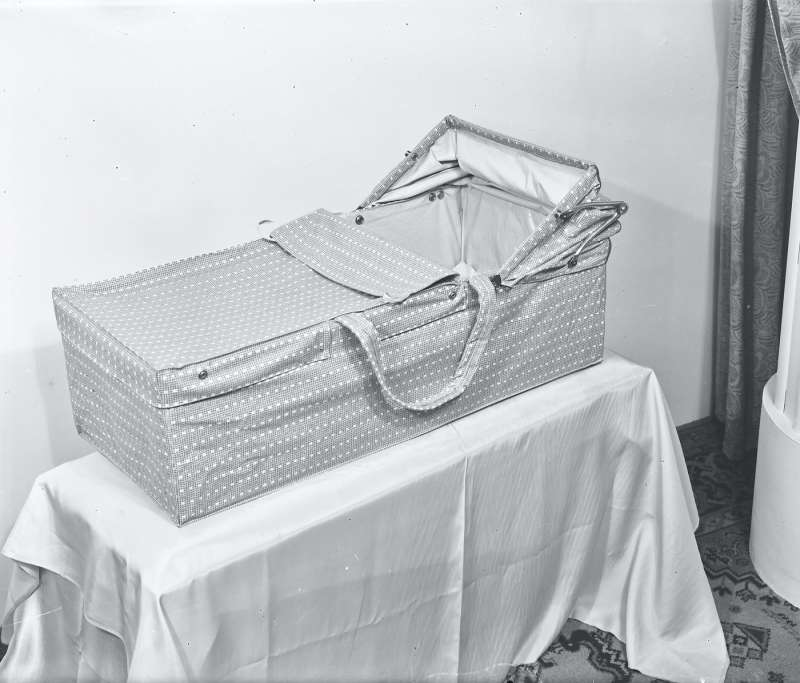 Carry cot on table