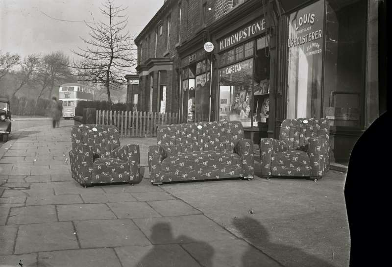 Three piece suite outside Louis Upholsterers