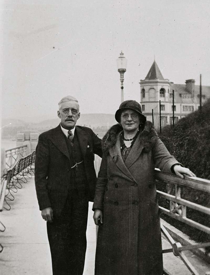 Copy family snap of a couple on a seaside promenade