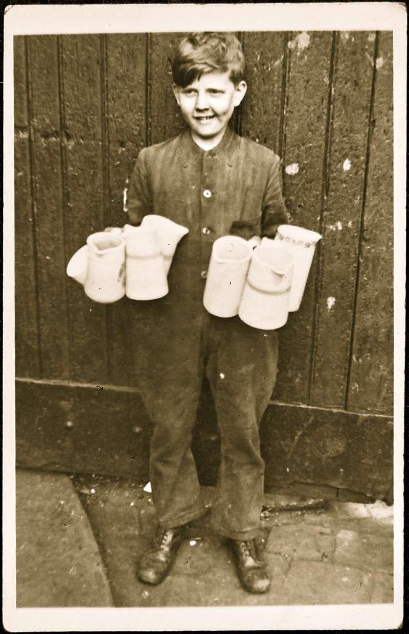 Boy carrying jugs